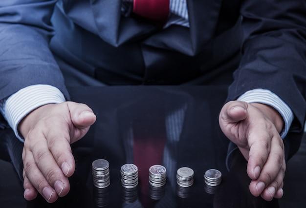 Businessman protected money coins Premium Photo
