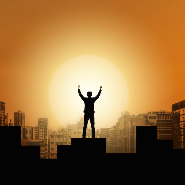 Businessman raise arms up in victory moment Premium Photo