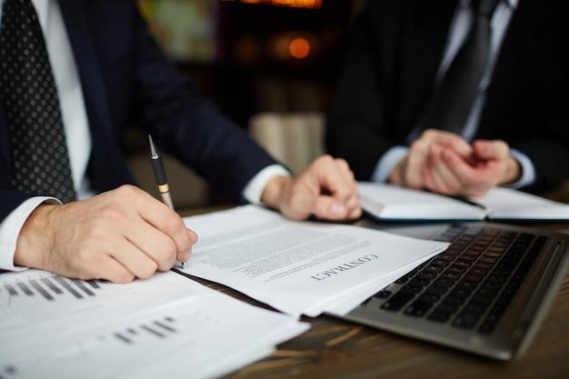 Businessman reading contract closeup Free Photo