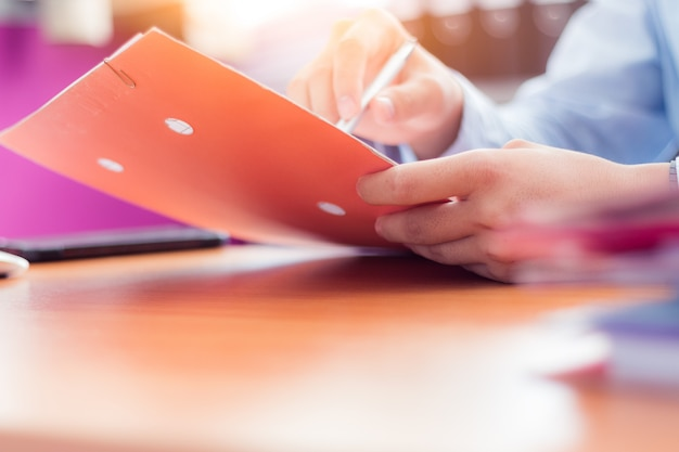 Businessman reading documents before signing important documents in office. Premium Photo