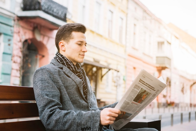 Businessman reading a newspaper Free Photo