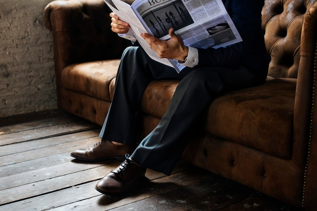 Businessman reading newspaper Premium Photo