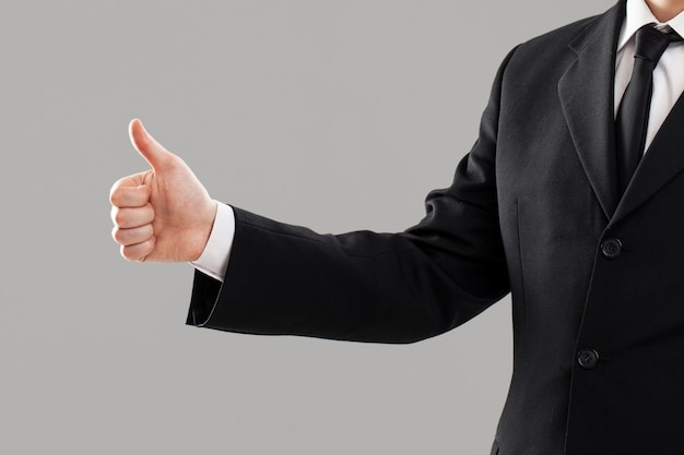 Businessman's torso with thumb up Free Photo