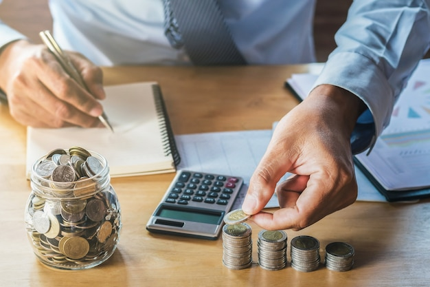 Businessman saving money. concept finance and accountimg Premium Photo