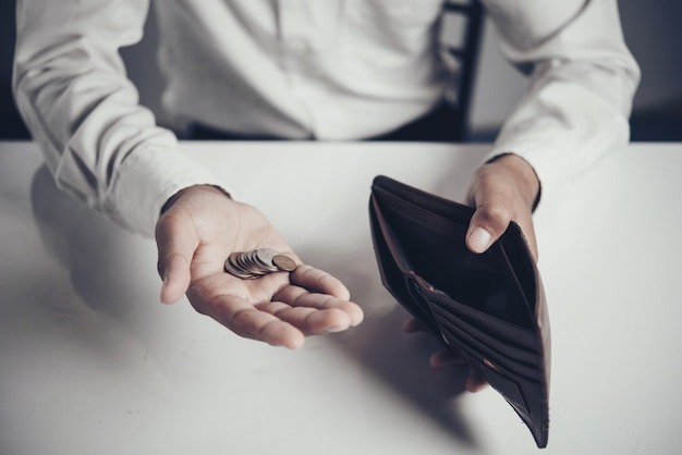 Businessman saving money Free Photo