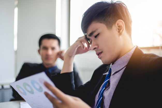 Businessman serious about the  work hard done until the headache Premium Photo