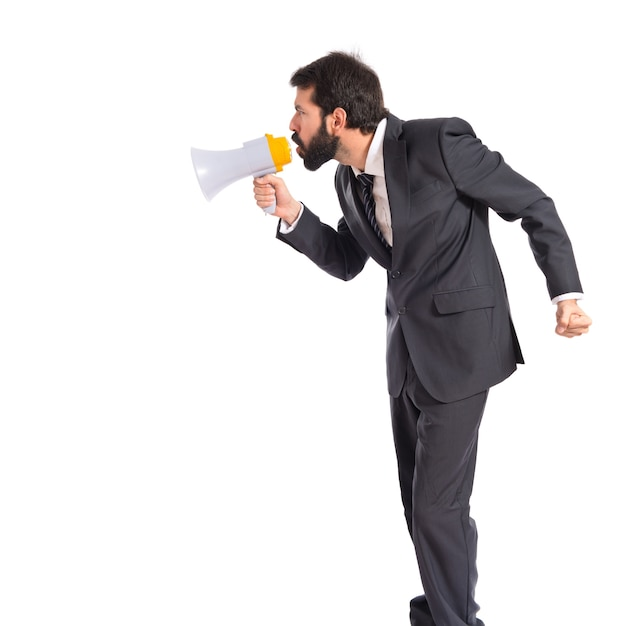 Businessman shouting over isolated white background Free Photo