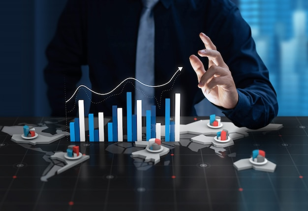 Businessman show chart profit on digital world map screen Premium Photo