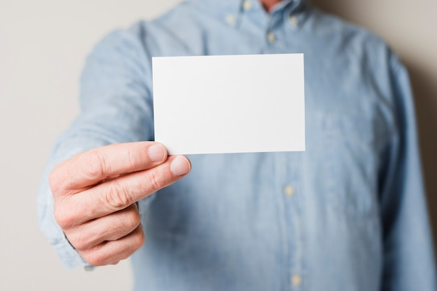 Businessman showing card Free Photo