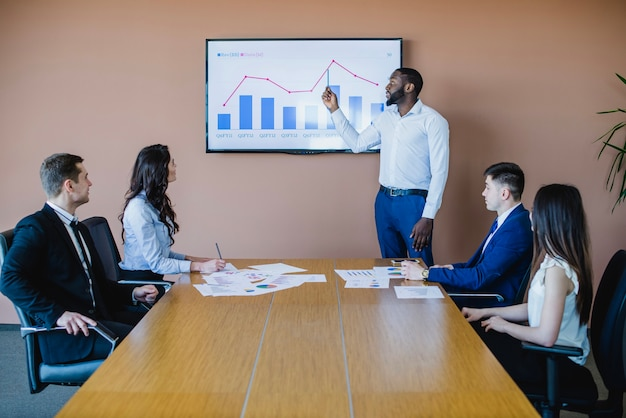 Businessman showing graph on board Free Photo