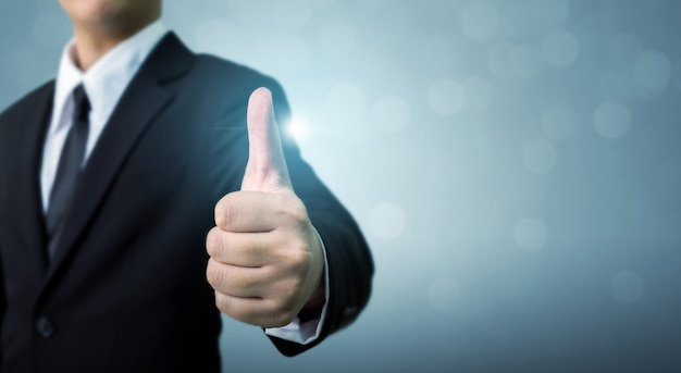 Businessman showing ok or hand sign thumb up Premium Photo