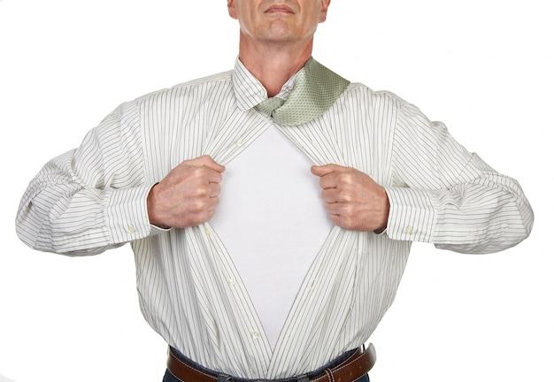 Businessman showing a superhero suit underneath his shirt Premium Photo