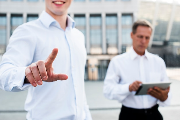 Businessman showing two gesture Free Photo