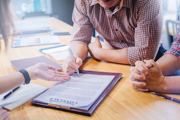 Businessman sign in contract with partnership in meeting Premium Photo