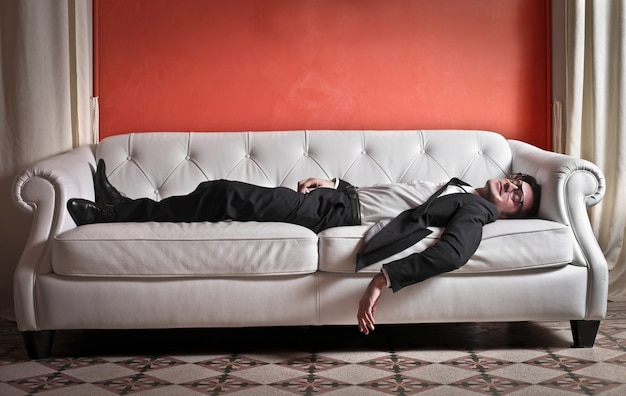 Businessman sleeping on a couch Premium Photo