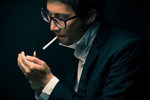 Businessman smoking a cigarette Premium Photo