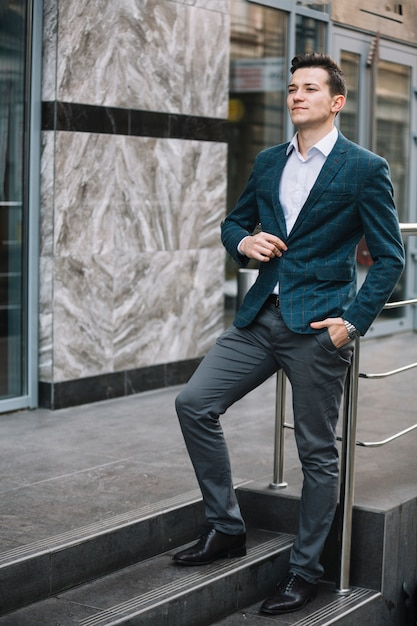 Businessman on the stairs Free Photo