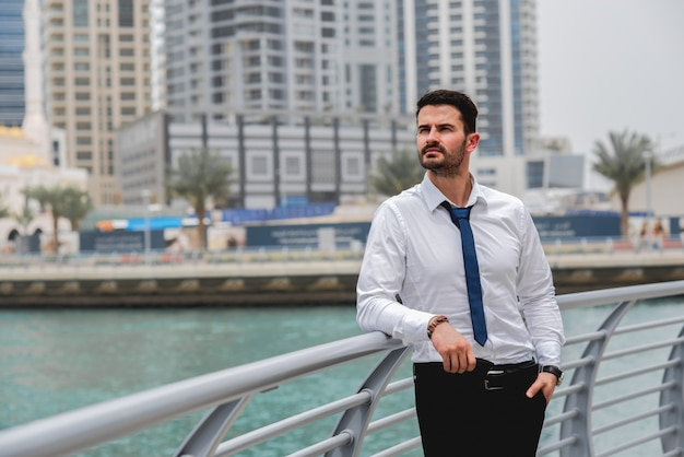 Businessman standing thinking near river. Premium Photo