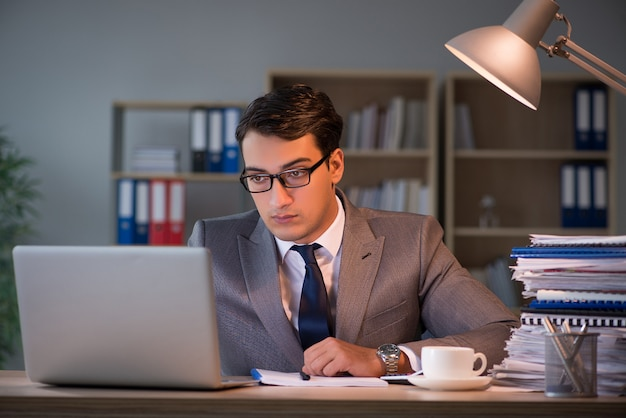 Businessman staying in the office for long hours Premium Photo