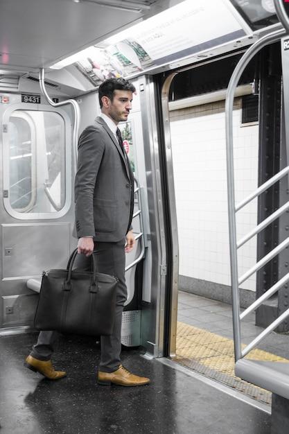 Businessman in subway car Free Photo