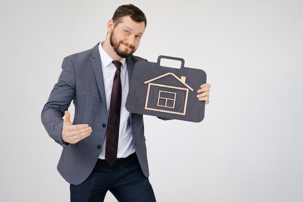 Businessman in suit portrait hold briefcase in hand Premium Photo