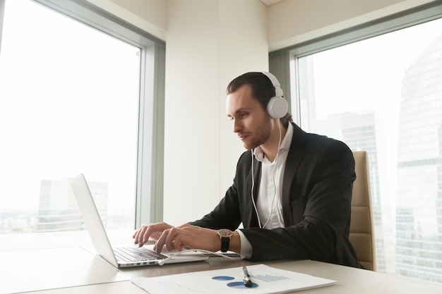 Businessman takes part in online conference Free Photo