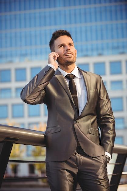 Businessman talking on mobile phone Free Photo