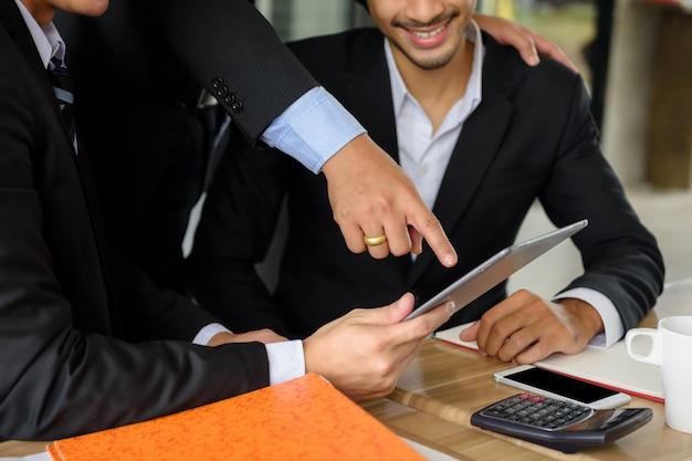 Businessman team discuss plan by tablet Premium Photo