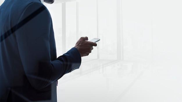 Businessman texting Free Photo