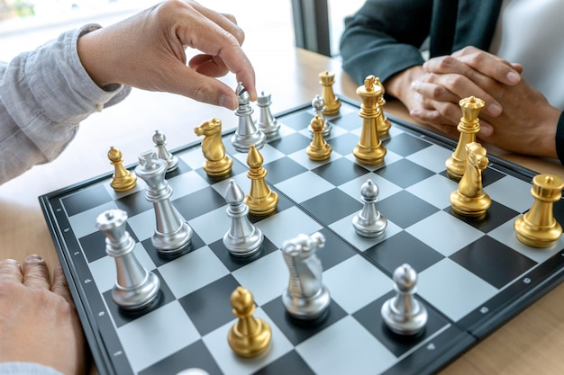 Businessman thinking and hold king chess on his hand, Premium Photo