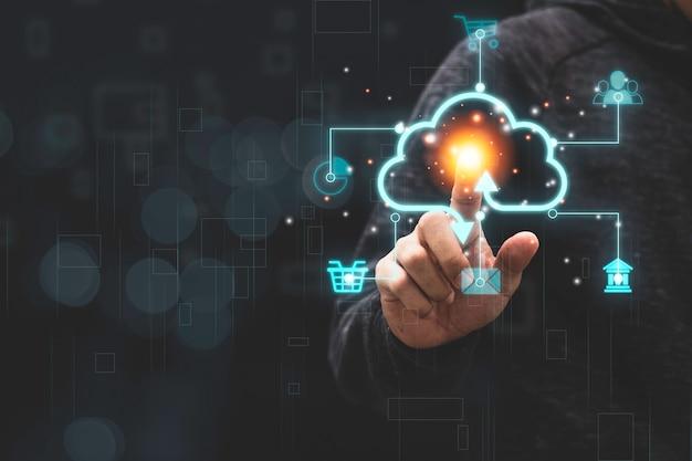 Businessman touching virtual cloud computing with icon to transfer data Premium Photo
