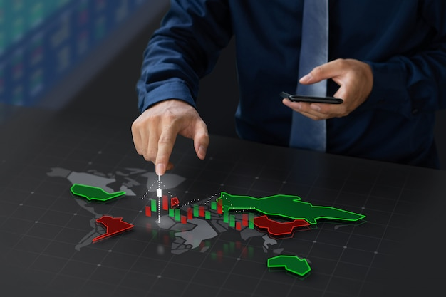 Businessman trading stock market on digital world map screen Premium Photo