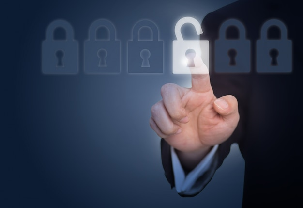 Businessman unlocking a lock on the touch screen Free Photo