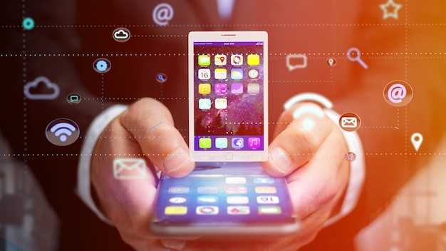 응용 프로그램 및 소셜 아이콘 -3d 렌더링으로 태블릿 주변 스마트 폰을 사용하는 사업가 프리미엄 사진
