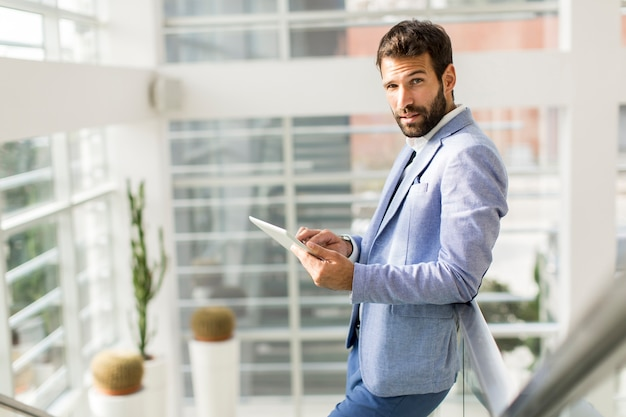 Businessman using his digital tablet at the office Premium Photo