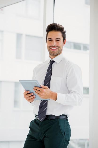 Businessman using laptop and taking notes Premium Photo