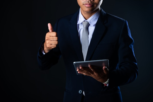 Businessman using tablet analyzing sales data and economic growth graph chart, technology Free Photo