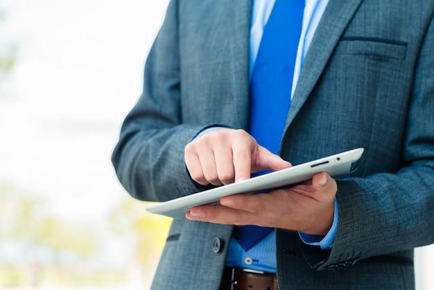 Businessman using tablet computer Premium Photo