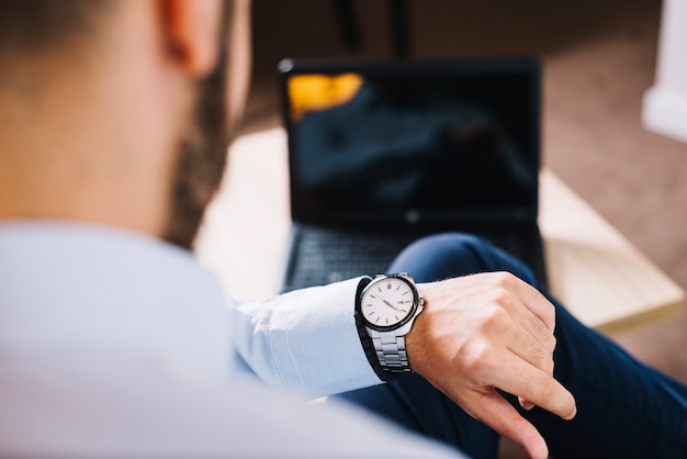 Businessman watching time Free Photo