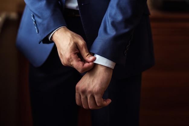 Businessman wears a jacket.politician, man's style,male hands closeup, ,  businessman, business, fashion and clothing concept Premium Photo