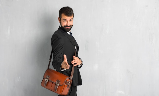 Businessman with beard handshaking after good deal Premium Photo