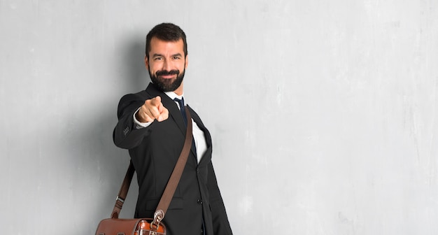 Businessman with beard points finger at you with a confident expression Premium Photo