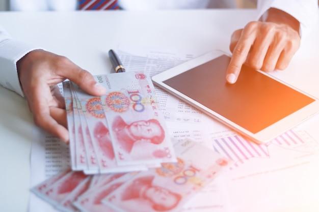Businessman with cash yuan Premium Photo