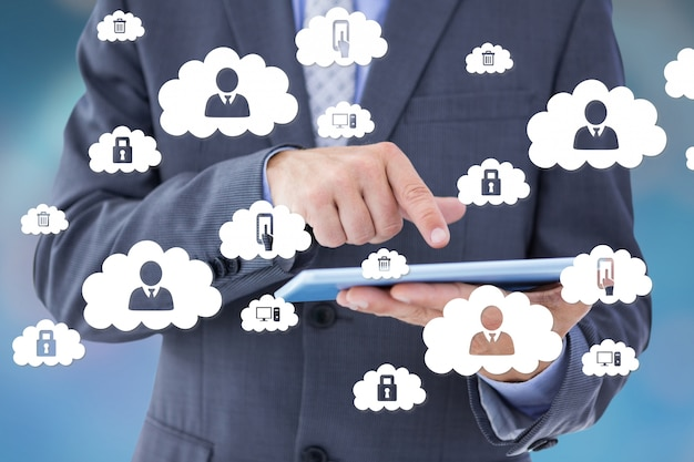 Businessman with cloud icons Free Photo
