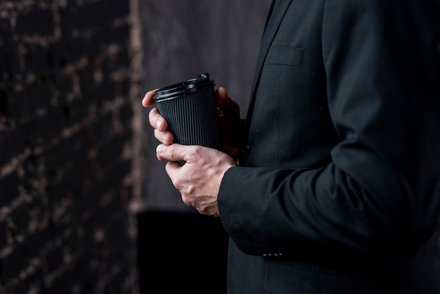 Businessman with coffee in paper cup Free Photo