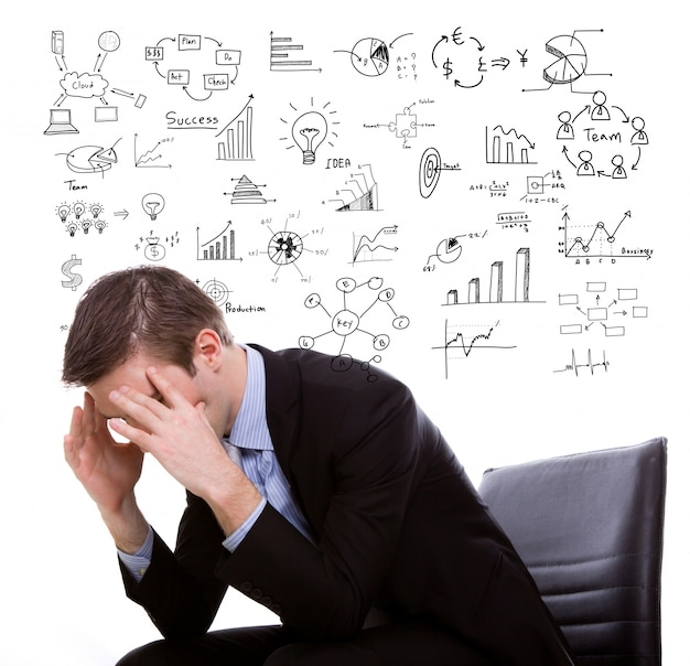 Businessman with hands on head and symbols behind Free Photo