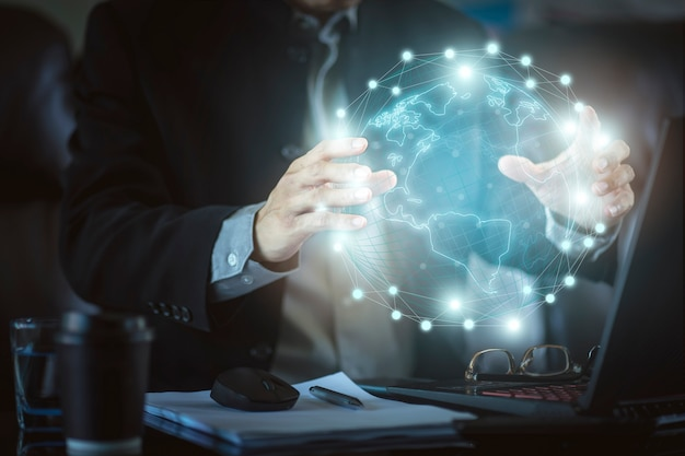 Businessman with hi technology virtual reality profit graphic. concept of business technology and digital marketing. Premium Photo