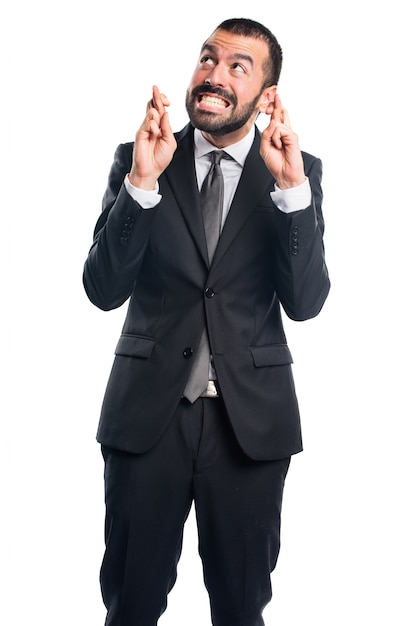 Businessman with his fingers crossing Free Photo