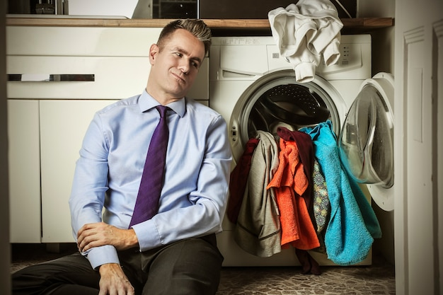 Businessman with house chores Premium Photo
