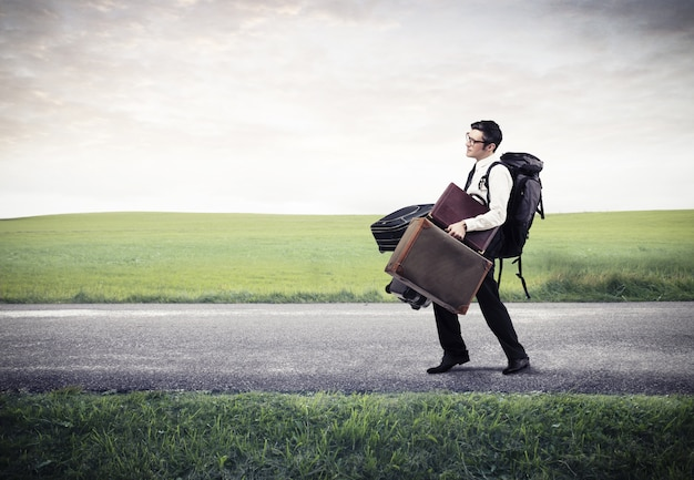 Businessman with a lot of baggages Premium Photo